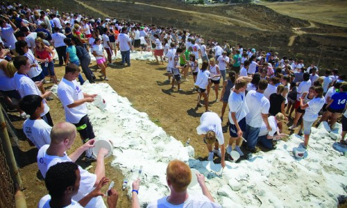 A messy afternoon: Students participate in the tradition of painting the CLU rocks during freshman orientation in 2009.