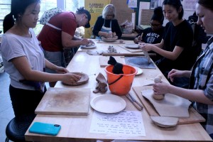 Students begin building clay models of their banquet plates at the first pottery station set up in the William Rolland Art Center ceramics room. Photo by Joc Smith - Photojournalist