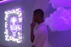 """Kiyoshi Taylor (pictured), Annabelle Worrall, and Andrew Tufenkian created """"The Purple Room,"""" part of the multimedia capstone exhibit CLUFest """"Colors.""""   Photo by Katie May- Photojournalist."""