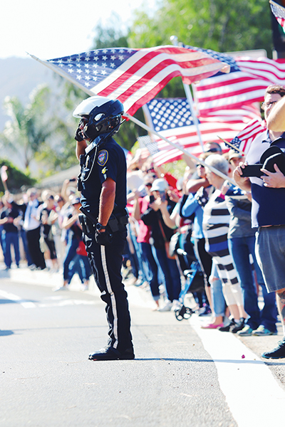 Crowds line a street leading to the Nov. 15 memorial for sheriff's Sgt. Ron Helus in Westlake Village. (Award-winning photo by Arianna Macaluso for The Echo.)
