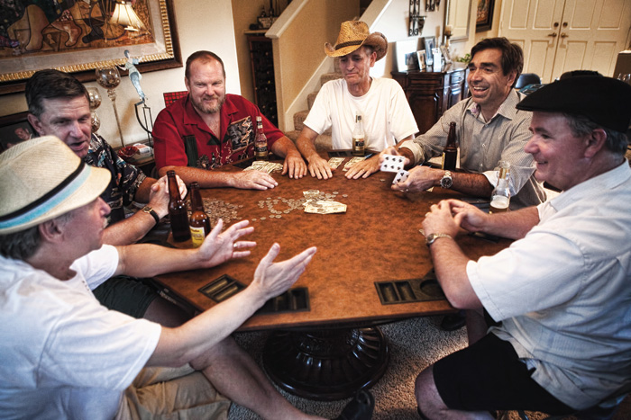 Dan Naef (l), Mike Bloomgren '82, Guy Corrigan, Bob Voelker, Earl Slee and Dean Clark enjoy another spirited poker game in memory of their friend Sven Slattum '82.