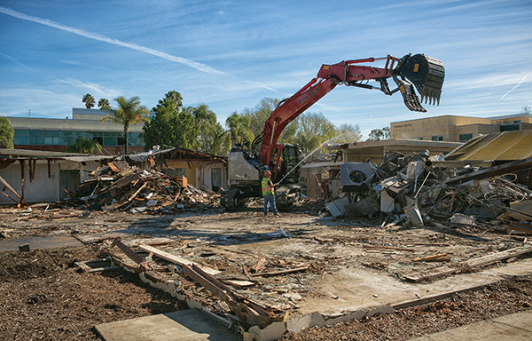 "Workers take apart ""F"" Building, one of the ranch structures that predates California Lutheran College. (Photo by Brian Stethem '84)"