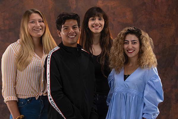 From left are sophomore political science major Susanna Zdolsek of Sweden, senior political science major Erik Arias of Ecuador, freshman biology major Rama Youssef of Syria and junior music major Tamar Haddad, who was born in Jerusalem and has studied in the West Bank and South Korea. They hold scholarships from three different programs created since 2015. (Photos by Brian Stethem '84)