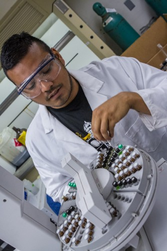 "Senior chemistry major Philip Albornoz uses gas chromatography–mass spectrometry in one part of the study. ""Even if they hadn't paid me over the summer, I would have done it,"" he said."