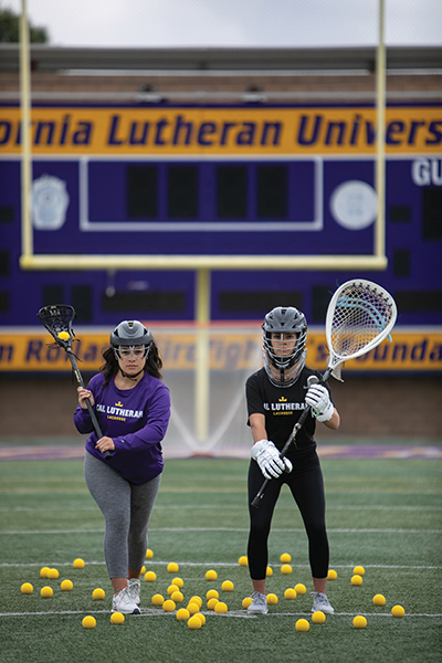 Active participants in the sport's growth, sisters Sarah (left) and Cameron Mendez pushed to start lacrosse teams at their high school and now Cal Lutheran. (Photo by Brian Stethem '84)