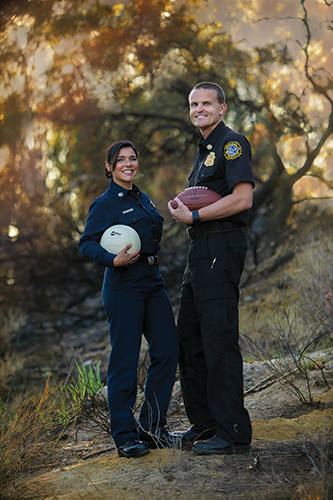As business majors and college athletes in the 1990s, these two firefighters pictured themselves in other careers. Cal Lutheran helped to shape them into the people we needed in December. (Photo by Brian Stethem '84)