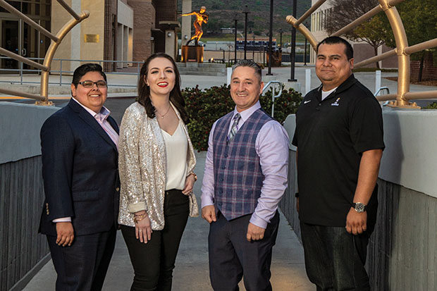 Celebrating the launch of the School for Professional and Continuing Studies in February are, from left, Claira Bailey-Guerra '19, Nichol Cruz '18, current student Tony Ayala and Jose Carcamo '18. (Photo by Brian Stethem '84)