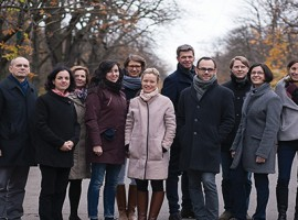 MBA in Europe student Nora Pötter (center, in light-toned coat) and her 12-person staff at Dr. Raab & Dr. Böhm Artists Management handle the details for classical musicians in Austria and beyond.