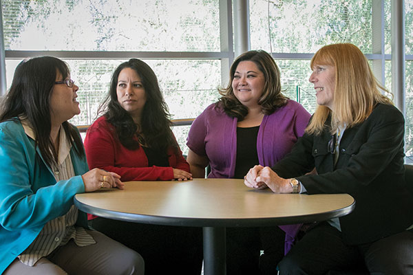 The counselor education faculty includes, from left, Cynthia Jew, Ph.D., Heidi Coronado, M.S. '04, Ph.D., Angela (Namba '02) Rowley, M.S. '05, and Gail Uellendahl, Ph.D., T.C. '03. (Photo by Brian Stethem '84)