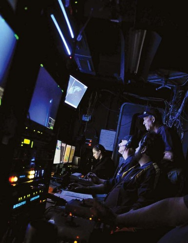 Robert Ballard, right, with crew members in the nerve center of the E/V Nautilus. (Photo by Melissa Baffa '95)