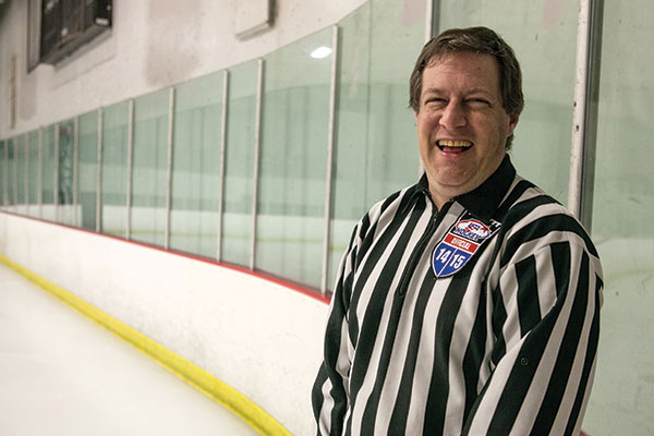 """Hockey really saved my life,"" says Scott Klein '90. He takes to the ice two or three times a week to officiate Southern California adult leagues, including at the Iceoplex in Simi Valley. (Photo by Brian Stethem)"
