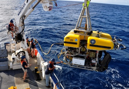 The crew of the Nautilus starts the Hercules ROV on its journey into the ocean depths. (Photo by Melissa Baffa '95)