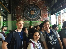 Physics majors Johann Dias (left), Hend Kordy and William Parquette stand before a mock-up of a gigantic detector in Geneva, Switzerland, that is getting an upgrade. Their mentor, Sebastian Carron Montero, joined Cal Lutheran in 2016.