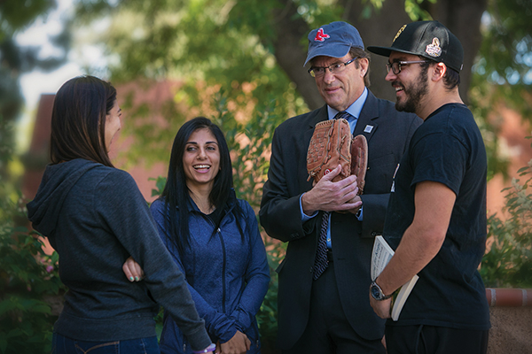 With President Kimball are students from his history of baseball course: sophomore biochemistry major Nicole Kuriki (left), junior communication major Zhamak Fooladbakhsh and senior geology major William Zimmerle. (Photo by Brian Stethem '84)